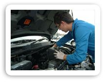 mechanic working on part of car engine